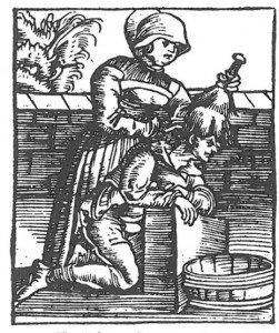Fig. 3. Hodelus børstes ut av håret og ned på dette tresnitt fra 1536. Teksten siterer Plinius den eldre som sier at lus oppstår på en usynlig måte av menneskets kropp.